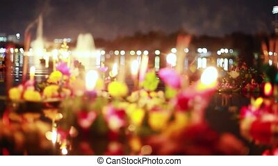 Loy Kratong Festival celebrated in Thailand. Launch boats from beautiful flowers and candles in the pond.