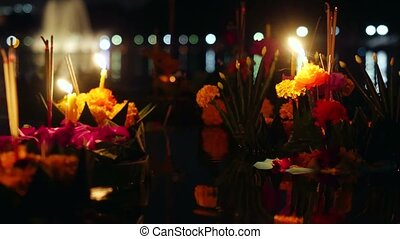 Loy Kratong Festival celebrated in Thailand. Launch boats from flowers and candles in the pond