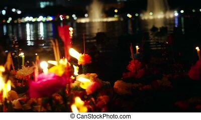 Loy Kratong Festival celebrated in Thailand. Launch boats from flowers and candles in the pond.