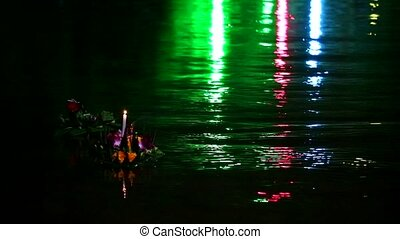 """Loy Kratong Festival reflection light on the water in the lake, Some evidence is believed to be the worship of the Buddha's footprint on the banks of the Namtha Mahanathi River"""