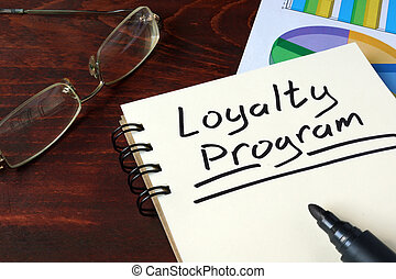 Loyalty Program  concept on a paper with charts.