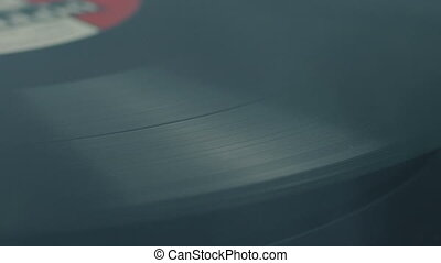 LP Vinyl Record In Smoky Club - Closeup shot of vinyl LP on...