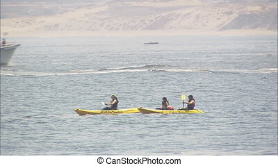 LS Kayakers and Sport Fishermen - LS of a tandem kayak and a...