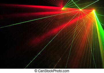 Color laser beams on a black background.