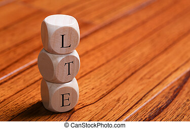 LTE Block Word - LTE wooden blocks are on the wooden floor...