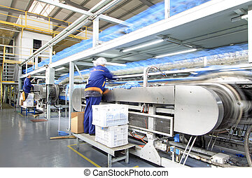 Workers in the PVC gloves production lines in a factory