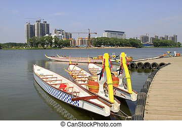 LUANNAN - JUNE 14: Dragon boat anchored on surface of river in North River Park on June 14, 2013, Luannan, Hebei Province, China.