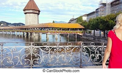 Kapellbrucke historic flowered Chapel Bridge with Water Tower over Reuss river on Lake Luzern. Lucerne is a famous city of ancient bridges in Switzerland.