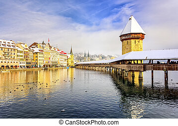 Lucerne, Switzerland, Chapel bridge and Water Tower on a snowy winter day