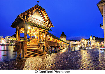Lucerne, Switzerland, entrance to wooden Chapel Bridge at late evening