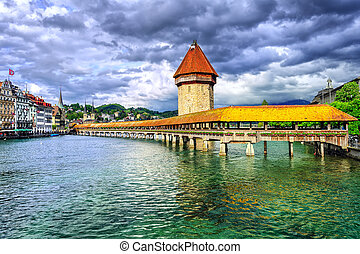 Lucerne, Switzerland, wooden Chapel bridge over Reuss river and Water tower