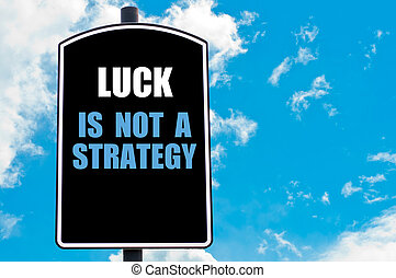 LUCK IS NOT A STRATEGY motivational quote written on road...