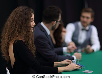 luckiest woman on the background of the players in the casino.