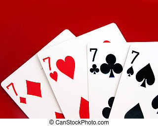 lucky 7s playing cards - four 7 cards lying flat on red ...