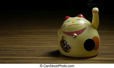 Lucky Asian Cat on dark background