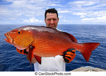 red snapper - lucky fisherman holding a beautiful red ...