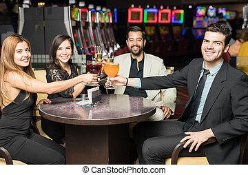 Lucky friends celebrating in a casino
