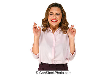 Lucky happy girl with crossed fingers - Hilarious happy...
