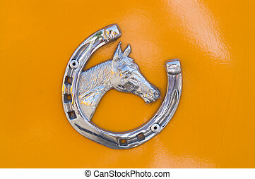 Detail of metallic horse shoe with horse head