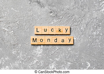 lucky monday word written on wood block. lucky monday text on cement table for your desing, concept
