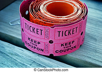 Lucky Roll - Roll of raffle tickets on a wooden table.