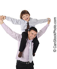 lucky son sitting on his father stretches