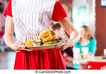 ludzie, amerikanka diner, albo, restauracja, jedzenie, mocne jadło