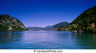 Lugano city and lake. - Scenic view of Lugano city shoreline...