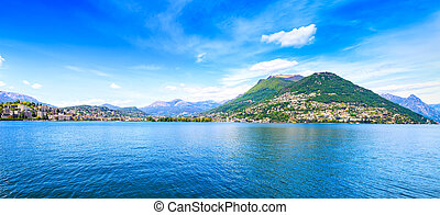 Lugano Lake panoramic landscape. City and mountains. Ticino...
