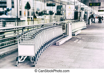 Luggage carts in front of airport entrance