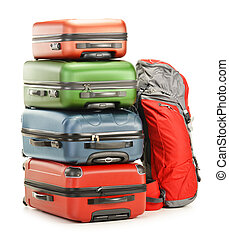 Luggage consisting of large suitcases and rucksack isolated on white