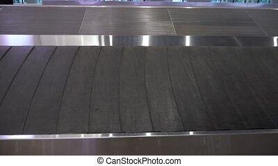 Luggage conveyor belt in the airport terminal, closeup view.