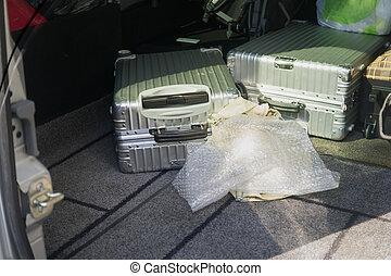 Luggage in a car trunk
