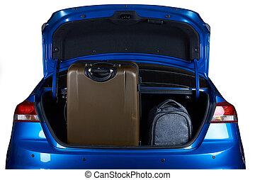Luggage in blue modern sedan car trunk