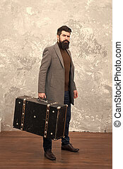 Luggage insurance. Man well groomed bearded hipster with big suitcase. Travel and baggage concept. Hipster traveler with baggage. Ready for relocation with baggage. Start journey. On way to new life