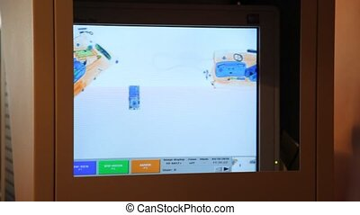 luggage is shown on monitor in the airport on the safety control