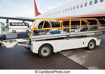 Luggage On Conveyor Belt Being Unloaded