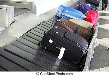 luggage - suitcases on a luggage band on the airport