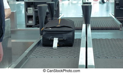 Luggage suitcase getting transported into flight