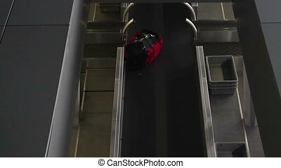 Luggage travels on a conveyor belt at the airport