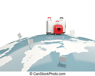 Luggage with flag of albania. Three bags on top of globe
