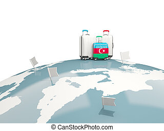 Luggage with flag of azerbaijan. Three bags on top of globe