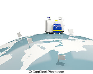Luggage with flag of curacao. Three bags on top of globe