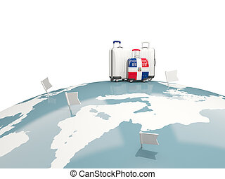 Luggage with flag of dominican republic. Three bags on top of globe