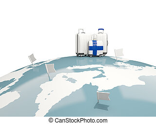Luggage with flag of finland. Three bags on top of globe