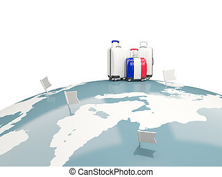 Luggage with flag of france. Three bags on top of globe