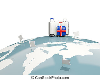 Luggage with flag of iceland. Three bags on top of globe