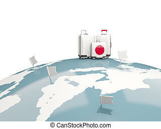 Luggage with flag of japan. Three bags on top of globe