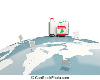 Luggage with flag of lebanon. Three bags on top of globe
