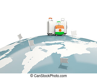 Luggage with flag of niger. Three bags on top of globe